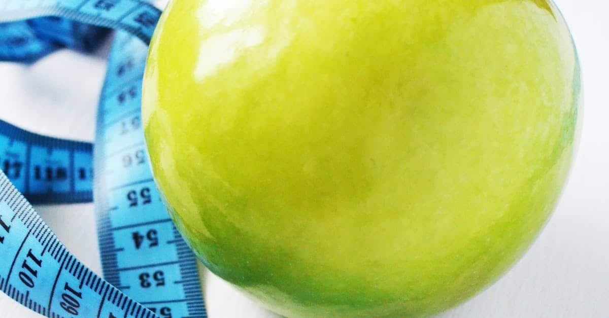 A close up of a green apple